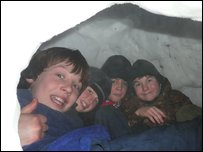 The boys in the igloo ready for bedtime