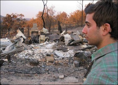 Ricky looking at burnt down house