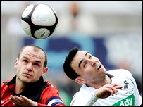 Danny Murphy of Fulham and Leon Britton of Swansea City  (Photo by Shaun Botterill/Getty Images)
