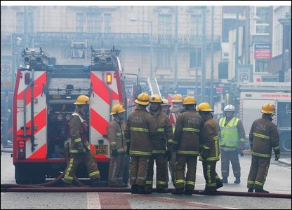 Firefighters tackle a blaze at a shopping centre in Blackpool (photo by Peter Byrne/PA Wire)