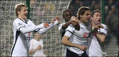 Jonathan Woodgate (second from right) celebrates scoring the winning goal  (photo by Nick Potts/PA Wire)