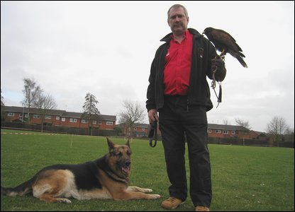 Graham Rees with his dog and a hawk