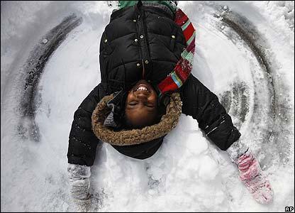 Jamilya makes a snow angel in Washington