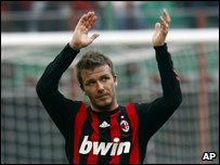 David Beckham applauds supporters as he walks off the field after a Serie A soccer match (AP Photo/Luca Bruno)