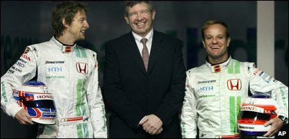 Jenson Button, left, and Rubens Barrichello with Ross Brawn, centre (AP Photo/Matt Dunham)