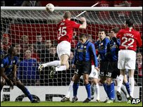 Nemanja Vidic, center left, scores against Inter Milan  (AP Photo/Jon Super)