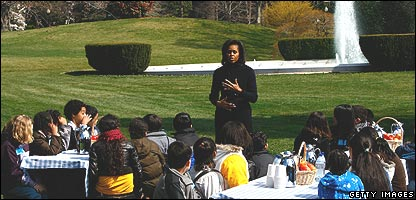 Michelle Obama with a young gardener