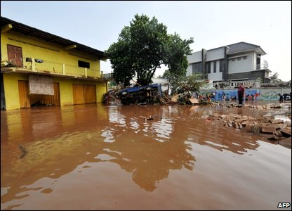 Flooded homes (Photo by ADEK BERRY/AFP/Getty Images)