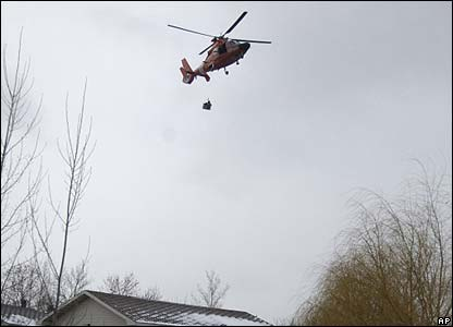 A helicopter rescuing people in Dakota