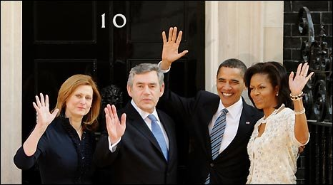 The Browns and Obamas wave from the door of 10 Downing Street