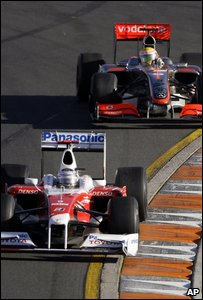 Jarno Trulli ahead of Lewis Hamilton during the Australian Grand Prix