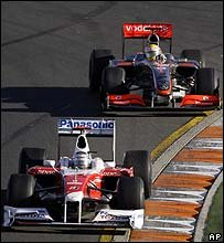 Jarno Trulli leads Lewis Hamilton at the Australian Grand Prix