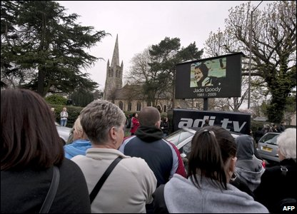 Large screens outside the church where Jade's funeral is being held