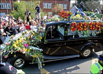 Jade's funeral procession leaves the church for a private burial