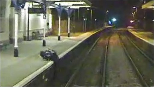A trespasser at a railway station has a lucky escape