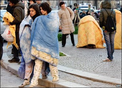 Survivors in blankets.