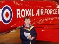 Press Packer Oliver standing next to a Red Arrows' plane.