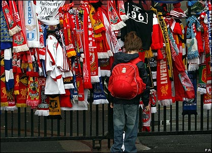 A boy at the Shankly Gates at Anfield