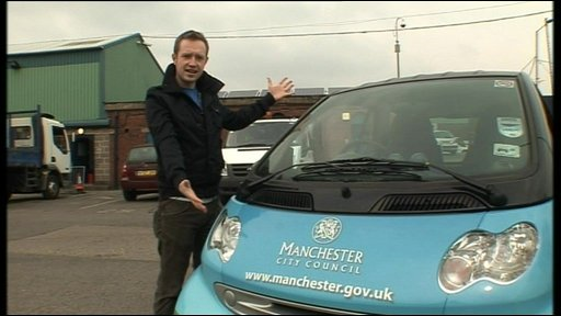 Adam with an electric car