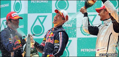 Sebastian Vettel enjoys a soaking session on the podium
