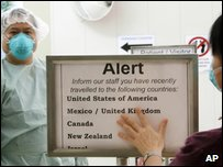 Sign asking people to let hospital staff know if they've been to a country that's been hit by swine flu