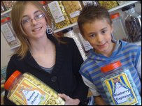 Emily and Adam with jars of their winning sweets
