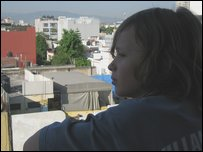 Eliott on his balcony looking over Mexico City
