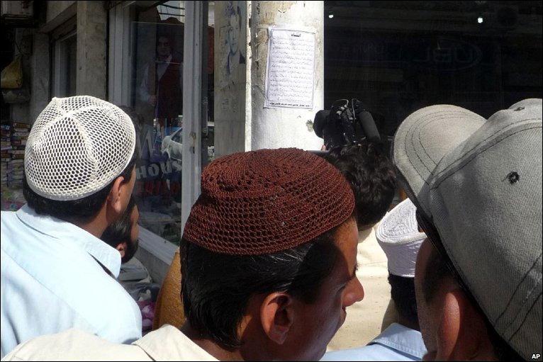 Local residents of mingora capital of swat valley read a warning