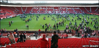 Fans invaded the pitch after Southampton's relegation was confirmed with a 2-2 draw against Burnley