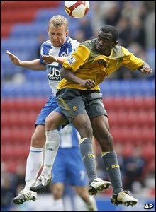 Wigan Athletic's Lee Catermole (left) goes for the ball with Bolton Wanderers' Fabrice Muamba