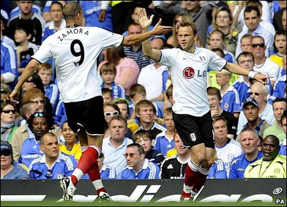 Fulham's Erik Nevland (right) celebrates with team mate Bobby Zamora
