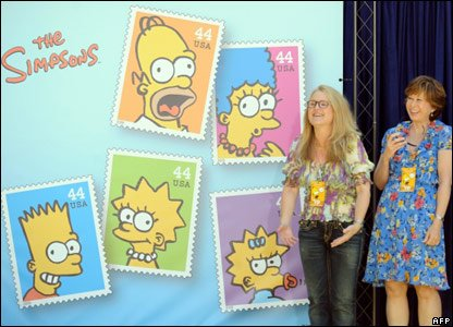 Actors Nancy Cartwright and Yeardley Smith, who provide the voices for Bart and Lisa, with the stamps