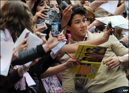 Nick Jonas poses for photos with fans