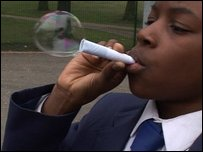 A boy blowing a bubble