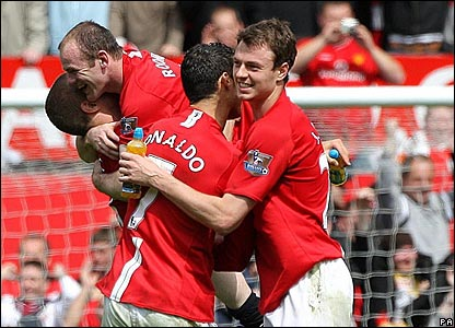 Ronaldo and Jonny Evans celebrate