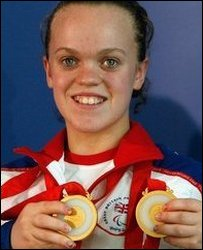 Ellie with her 2 gold medals at the Beijing Paralympics