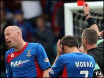 Inverness' Ross Tockley is sent off for a challenge on Falkirk's Steve Lovell