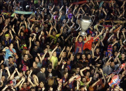 Barcelona fans celebrate in the stands