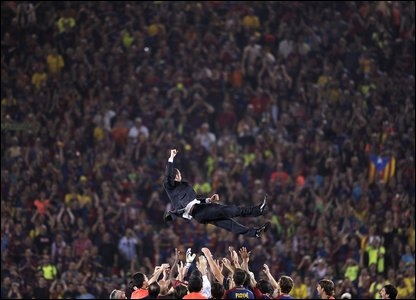 Barca are so happy they throw their manager into the air to celebrate!