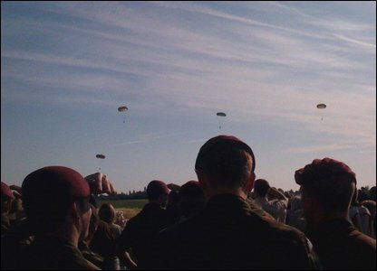 Parachutes dropping in Normandy