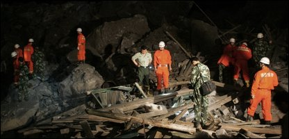 Rescuers at the site of the landslide
