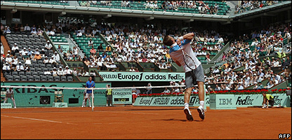 Players serving at Roland Garros