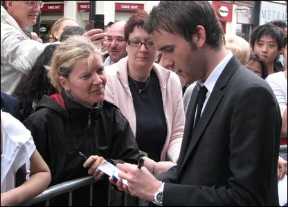 Matthew Lewis, who plays Neville Longbottom in the films, signing autographs for fans