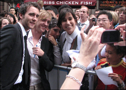 Matthew Lewis and Tom Felton pose for photos with fans
