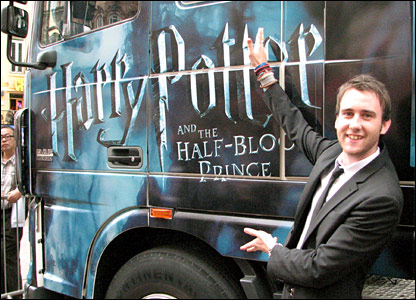 Matthew Lewis, who plays Neville Longbottom in the films, next to the Harry Potter tour truck