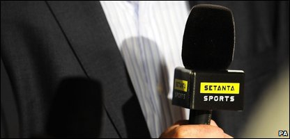Someone holding a Setanta Sports microphone