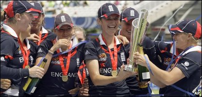 England's women cricketers lift their trophy