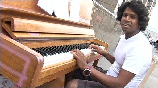 Gavin playing a piano on the streets of London