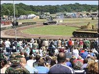 The crowds enjoy watching the tank display