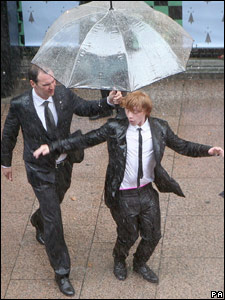 Rupert Grint dances in the rain at the world premiere of Harry Potter and the Half-Blood Prince in London